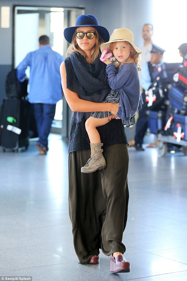 Fashionista-in-training! Jessica Alba carried her daughter Haven, four, when they jetted into New York on Tuesday