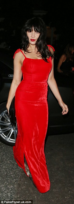 Lowe and behold: Daisy Lowe looked stunning in a Jessica Rabbit-inspired red gown, but ditched her heels for a pair of comfy boots at the bash