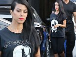 Kourtney Kardashian wearing super cool Lagerfeld tee shirt and bright lips at the studio September 8, 2015 X17online.com