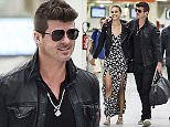 8.SEPT.2015 - PARIS - FRANCE **EXCLUSIVE ALL ROUND PICTURES** ROBIN THICKE AND NEW GIRLFRIEND APRIL LOVE-GEARY SEEM IN GOOD SPIRITS AS THEY ARRIVE AT ORLY AIRPORT IN PARIS! BYLINE MUST READ : E-PRESS / XPOSUREPHOTOS.COM *AVAILABLE FOR UK SALE ONLY* ***UK CLIENTS - PICTURES CONTAINING CHILDREN PLEASE PIXELATE FACE PRIOR TO PUBLICATION ****** **UK CLIENTS MUST CALL PRIOR TO TV OR ONLINE USAGE PLEASE TELEPHONE  44 208 344 2007 ***