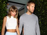 "UK CLIENTS MUST CREDIT: AKM-GSI ONLY..Santa Monica, CA - Taylor Swift and boyfriend Calvin Harris hold hands after a romantic dinner date at Giorgio Baldi Italian restaurant in Santa Monica. The 25-year-old singer showed off her slender figure in a white crop top and baby blue mini skirt. Taylor used Twitter to shoot down reports that she was buying a 16th century castle in Scotland. She tweeted, 'Cause baby I could build a castle out of all the bricks they threw at me¿But I'm not actually buying a castle."".....Pictured: Taylor Swift, Calvin Harris..Ref: SPL1100612  110815  ..Picture by: AKM-GSI / Splash News...."