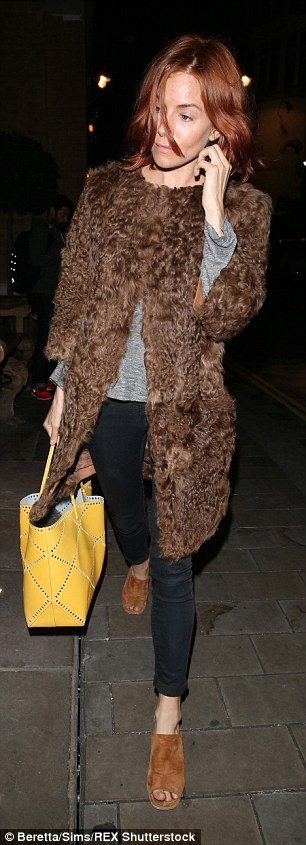 Low-key look: The 33-year-old kept things casual for her sister's big night in black trousers teamed with a grey sweater and furry coat