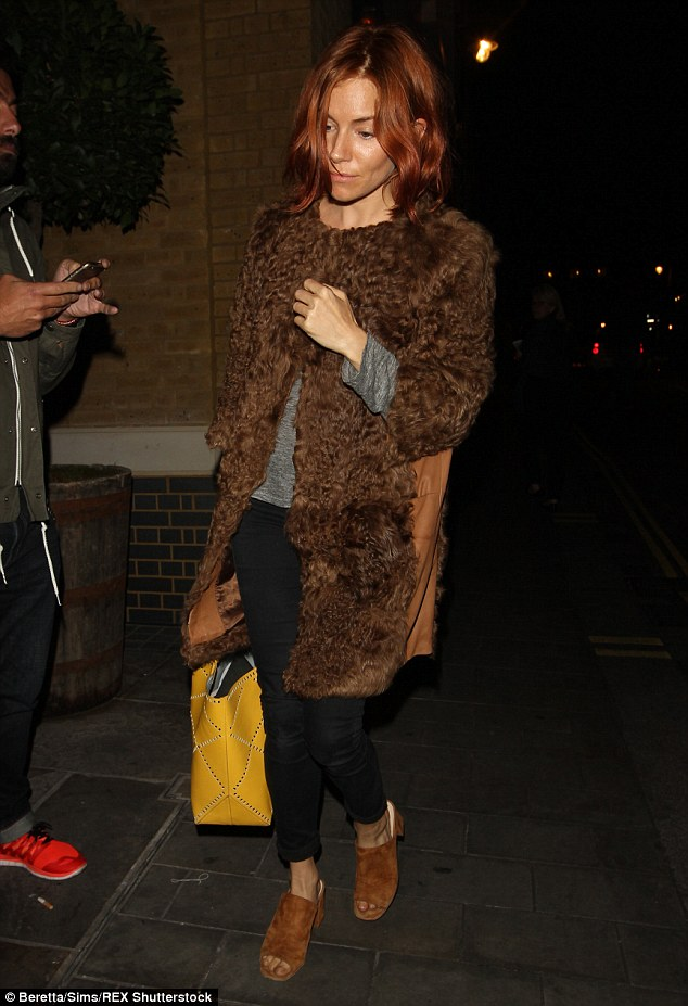Seeing red: The actress showed off her newly coloured locks as she headed to the fashion bash