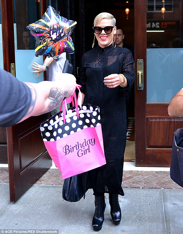 Not forgotten! The pop star appeared to be gifted a present and balloon