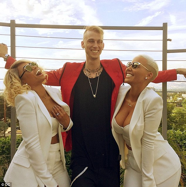 Moving on: Amber (R) was most recently linked to rapper Machine Gun Kelly (pictured - along with the model's best friend Blac Chyna, L)