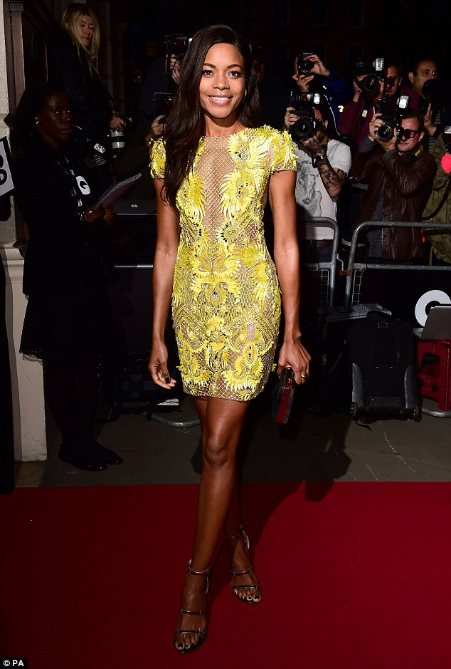 Colourful: The youthful-looking 38-year-old actress glowed as she dazzled in her tiny lemon yellow mini dress, complete with racy mesh panels all over