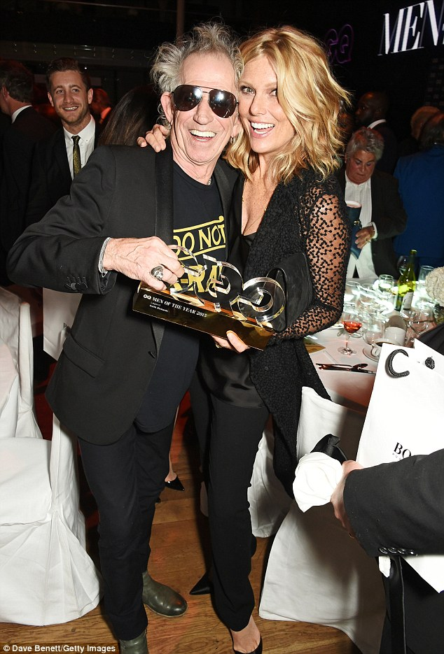 Let's celebrate: Keith Richards won the Legend Of The Year honour and looked delighted with his prize as he partied with his wife Patti