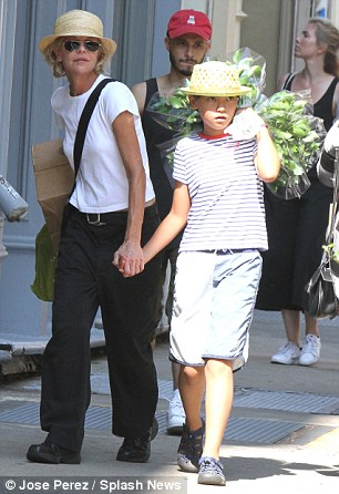 Running errands: The When Harry Met Sally star wore baggy pants and a t-shirt while her daughter had on a striped shirt with a whale motif and baggy shorts and sandals