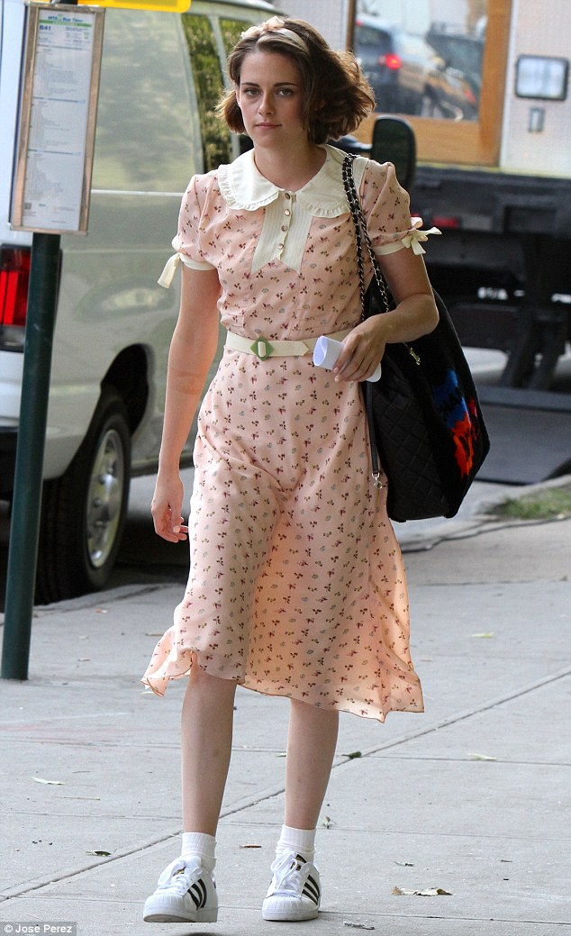 Retro style: For their walk to the set location, the 25-year-old was dressed as her character in a pink patterned dress with a Peter Pan collar which cinched in at the waist