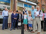 Picture: Craig Hibbert  23-7-15..Celebrity campaigners against the closure of Barclays Bank, Barnes. L to R. Julian Glover, Niamh Cusack, Isla Blair, Hayley Mills, Alistair McGowan, Peter Snow with campaign organiser William Mortimer, children in front, Jessie and Joe Williams...
