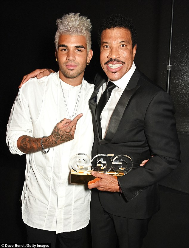 Family outing: Lionel Richie was joined by his son Miles at the London ceremony