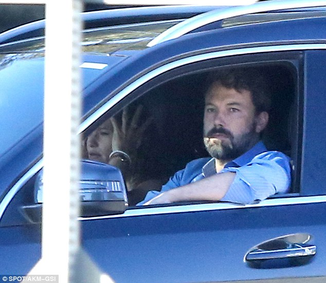 Business as usual: The 43-year-old actress fussed with her hair as Ben took the wheel