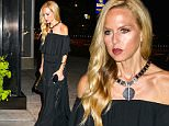 New York, NY - Rachel Zoe wears off-shoulder dress in NYC.\nAKM-GSI          September 8, 2015\nTo License These Photos, Please Contact :\nSteve Ginsburg\n(310) 505-8447\n(323) 423-9397\nsteve@akmgsi.com\nsales@akmgsi.com\nor\nMaria Buda\n(917) 242-1505\nmbuda@akmgsi.com\nginsburgspalyinc@gmail.com
