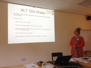 Image of Shirley Evans with a presentation slide about ALT Wales