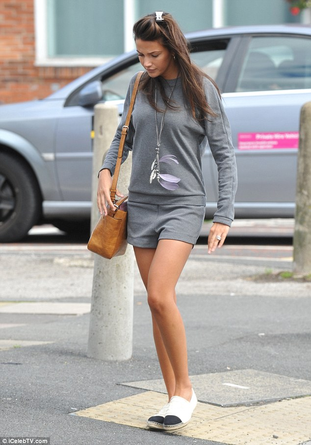 Stylish: The brunette beauty looked trim in a chic co-ord set, consisting of a grey sweatshirt and tailored shorts