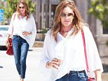 Caitlyn Jenner\nEXCLUSIVE TO INF. PLEASE CALL FOR PRICING.\nSeptember 8th, 2015:  Caitlin Jenner goes casual wearing a cape blouse and jeans as she makes a coffee run in Malibu, CA.\nMandatory Credit: SAA/INFphoto.com\nRef:infusla-301