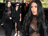 Kendall Jenner dons a sexy all black emsemble while meeting sister Kim Kardashian at the studio in NYC. September 8, 2015 X17online.com