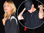 The Weeknd and girlfriend, Bella Hadid, were spotted together at Up and Down Nightclub in NYC on Tuesday night. The rarely seen couple put on a very public display of affection, holding hands as they left the club, with pal Hailey Baldwin Third-wheeling. The weeknd flashed his middle finger to the photographers as he crossed the street to his car. Bella looked stunning in black leather jeans, and a tight cleavage showing body suit.  Pictured: The Weeknd, Bella Hadid Ref: SPL1120184  080915   Picture by: 247PAPS.TV / Splash News  Splash News and Pictures Los Angeles: 310-821-2666 New York: 212-619-2666 London: 870-934-2666 photodesk@splashnews.com