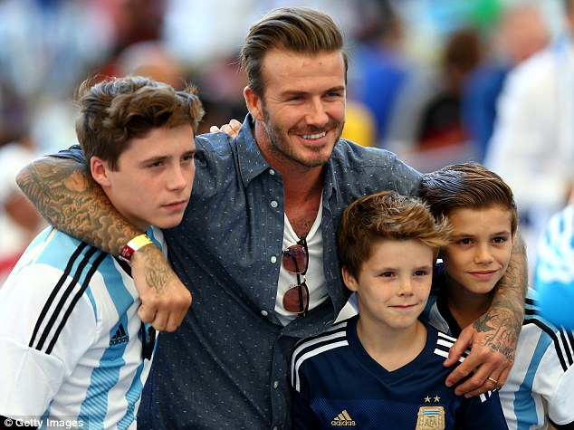 Family affair: David Beckham and sons Brooklyn (left), Cruz and Romeo (right) in Argentina shirts - their father must have forgiven the nation for France 98