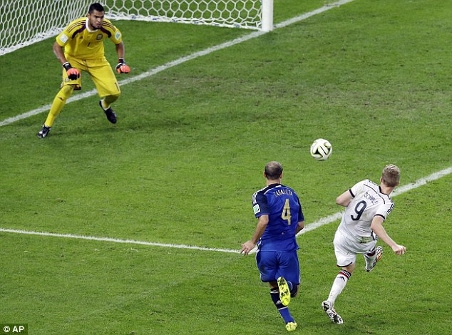 Going the extra mile: Andre Schurrle (right) has a shot saved right at the start of extra-time