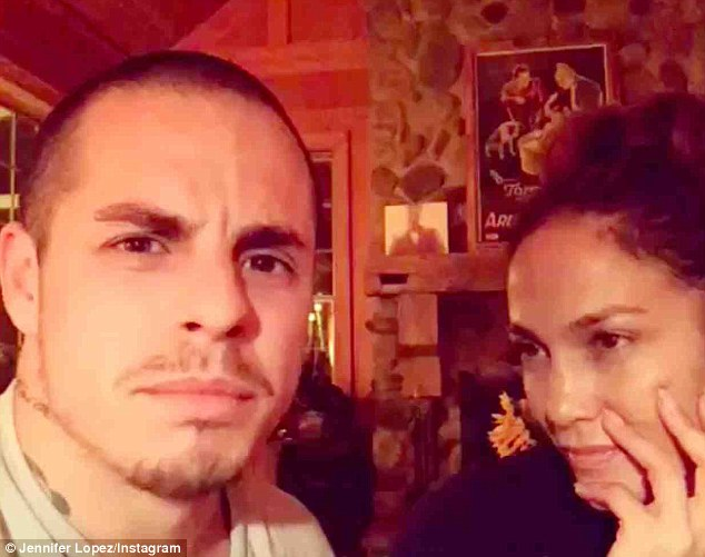 Young at heart: Make-up free Jennifer Lopez and her toyboy beau Casper Smart acted out a memorable Wedding Crashers scene in a funny Instagram video as they celebrated Labour Day together recently