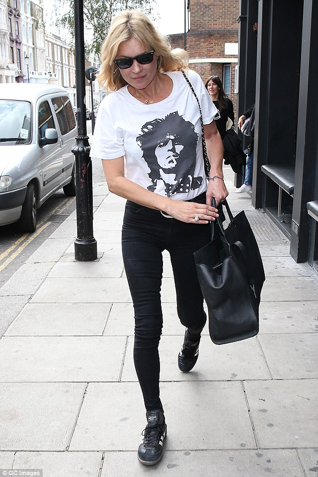 Off duty style: Kate Moss showed off her slim figure in a pair of ultra skinny jeans as she enjoyed a meal out in Notting Hill on Wednesday