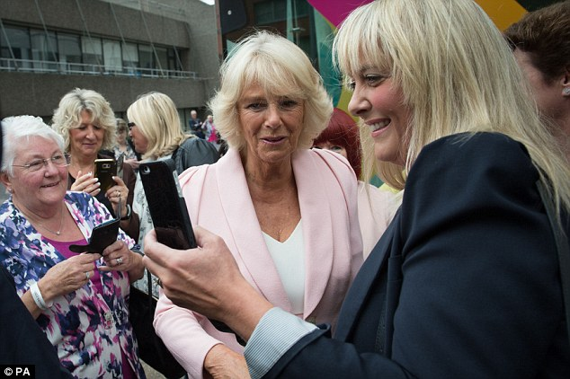 Royal selfie: The Duchess stopped to pose for a selfie with one of the well-wishers outside the studio