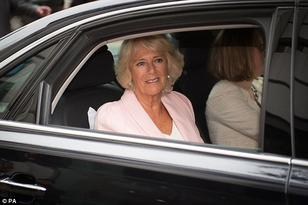 Heading off: Camilla is driven away after the visit, seated beside a lady in waiting in the back of her car