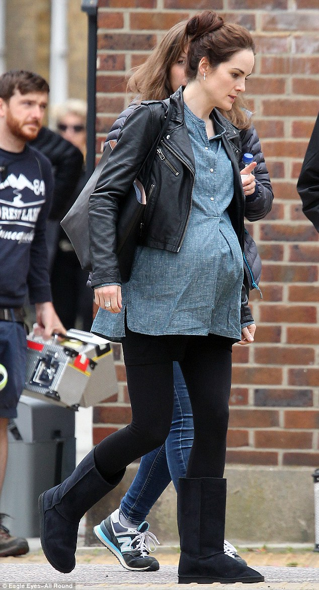All change: The 33-year-old actress' casual attire - and baby bump - cut a stark contrast to how fans are used to seeing her on the small screen
