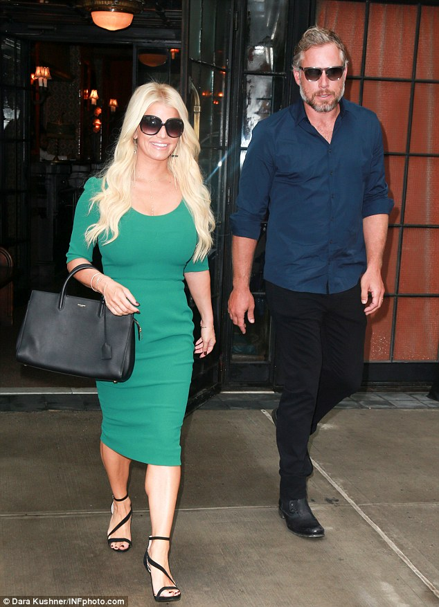 House husband:Jessica was joined at NBC Studios in Manhattan by her silver fox, Eric, who hasn't played football professionally since he was on the New Orleans Saints team back in 2008