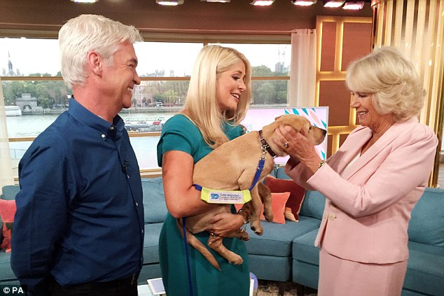 Impressed: She went onto praise the tiny puppy for its good behaviour and asked for tips