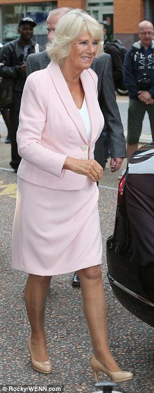 Looking good: The Duchess looked elegant in her pale pink skirt suit and nude Russell and Bromley heels