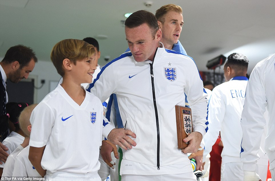 Romeo shows off his smile as he exchanges words with Rooney in the build up to England's Euro 2016 qualifier