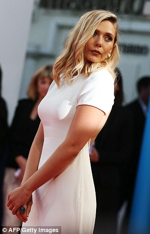 Red carpet pro: With her blonde locks coiffed into open, loose curls, she pouted for the cameras with panache