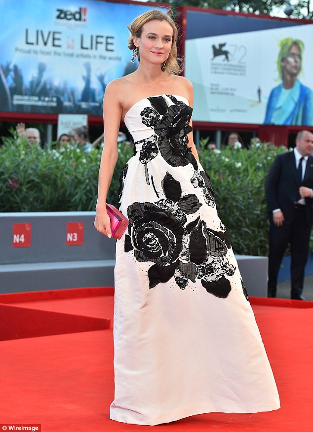 Pretty as a petal:The strapless number, complete with bold black floral prints and a clinched bodice, highlighted her toned, slender silhouette perfectly