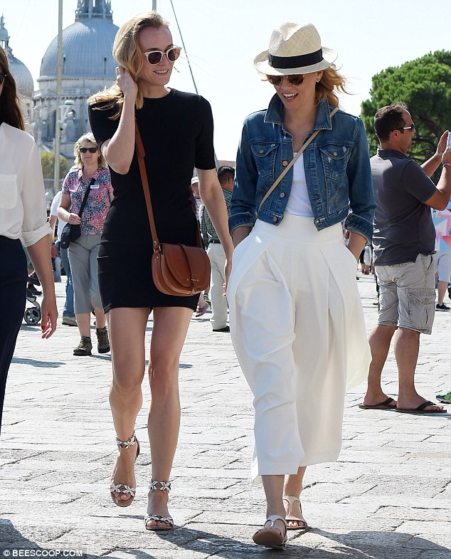 Leggy lady: She showed off her slender limbs in a short black dress, teamed with chic summery sandals and a brown leather handbag