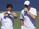 Dominic Ingot of Great Britain with his playing partner Robert Lundstedt of Sweden in action at the US Open 2015.