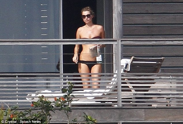 Feeling hot: The model looked at her best as she coolly stepped out onto the balcony