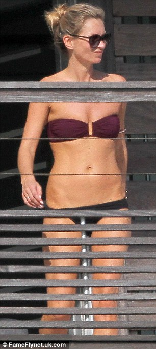 Home time: Kate had been seen relaxing on her balcony on Tuesday afternoon in another strapless bikini