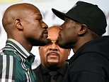 LAS VEGAS, NV - SEPTEMBER 09:  Floyd Mayweather Jr. (L) and Andre Berto face off during a news conference at MGM Grand Hotel & Casino on September 9, 2015 in Las Vegas, Nevada. Mayweather will defend his WBC/WBA welterweight titles against Andre Berto on September 12 at MGM Grand in Las Vegas.  (Photo by Ethan Miller/Getty Images)