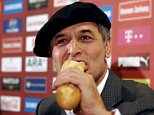 Austrian national soccer team coach Marcel Koller eats French bread during a news conference after the team qualified for the UEFA Euro 2016 in Vienna, Austria, September 9, 2015. REUTERS/Heinz-Peter Bader