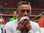 Emotional: An emotional Rooney walked down the tunnel after surpassing Sir Bobby Charlton's 45-year-old scoring record at Wembley