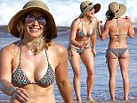 09.SEPT.2015 - Kihei - USA ***AVAILABLE FOR UK AND GERMANY SALE ONLY *** ***EXCLUSIVE ALL ROUND PICTURES AVAILABLE FOR UK NEWSPAPERS ONLY***  Hilary Duff takes some time away from the hustle of Hollywood and vacations in the Aloha state with her son Luca and girlfriend.  The former Disney star put her sexy curves and toned physique on full display in a little two piece bikini.  Hilary took Luca in the water to swim with large waves breaking in just off the shore.  The blonde bombshell is looking fantastic and proving she still has it compared to younger Hollywood. BYLINE MUST READ: XPOSUREPHOTOS.COM ***UK CLIENTS - PICTURES CONTAINING CHILDREN PLEASE PIXELATE FACE PRIOR TO PUBLICATION *** *UK CLIENTS MUST CALL PRIOR TO TV OR ONLINE USAGE PLEASE TELEPHONE 0208 344 2007*