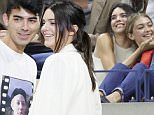 epa04921151 US television personality Kendall Jenner (L) and US model Gigi Hadid (R) watch as Venus Williams of the US plays Serena Williams of the US during their quarterfinals match on the ninth day of the 2015 US Open Tennis Championship at the USTA National Tennis Center in Flushing Meadows, New York, USA, 08 September 2015. The US Open runs through 13 September, which is a return to a 14-day schedule.  EPA/ANDREW GOMBERT