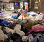 Refugees sleep amongst donations at the train station in Flensburg, northern Germany on September 10, 2015. Train transport has resumed after Danish train operator DSB cancelled all rail services to and from Germany as hundreds of migrants refused to disembark from trains arriving from Denmark's southern neighbour, demanding to be let continue onto Sweden instead.  AFP PHOTO / DPA / CHRISTIAN CHARISIUS +++ GERMANY OUT +++CHRISTIAN CHARISIUS/AFP/Getty Images