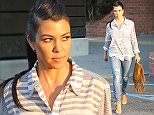 Kourtney Kardashian was spsotted visiting her local Calabasas Dentist for a check up.  The reality star went in a designer striped button-up and ripped jeans, on Wednesday, September 9, 2015 X17online.com