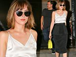 Dakota Johnson wears black and white outfit while carries her green purse in New York City\n\nPictured: Dakota Johnson\nRef: SPL1121375  090915  \nPicture by: Felipe Ramales / Splash News\n\nSplash News and Pictures\nLos Angeles: 310-821-2666\nNew York: 212-619-2666\nLondon: 870-934-2666\nphotodesk@splashnews.com\n