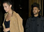 UK CLIENTS MUST CREDIT: AKM-GSI ONLY New York, NY - Bella Hadid and recording artist, The Weeknd return to their car after a romantic date night dinner in New York City.  Pictured: Bella Hadid and The Weeknd Ref: SPL1120026  080915   Picture by: AKM-GSI / Splash News