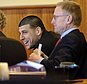 Aaron Hernandez, center, a former New England Patriots NFL football player, smiles at his attorney Michael Fee, left, as co-counsel Charles Rankin, right, listens during a pre-trial motion hearing in the Superior Court in Fall River, Mass., Friday, Dec. 12, 2014.  Judge Susan Garsh says prosecutors in the murder case against Hernandez may not tell jurors about two other killings with which the he is charged. Hernandez has pleaded not guilty to murder in the 2013 killing of Odin Lloyd, a semi-professional football player who was dating the sister of Hernandez's fiancee. He has also pleaded not guilty to the fatal shootings of two men in 2012 after an encounter at a Boston nightclub.  (AP Photo/The Boston Globe, Robert E. Klein, Pool)