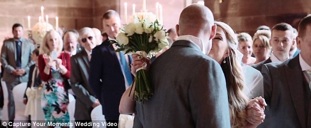 Kelly-Marie, pictured kissing her husband at the altar, went through months of gruelling neurological physiotherapy to build enough strength to walk down the aisle